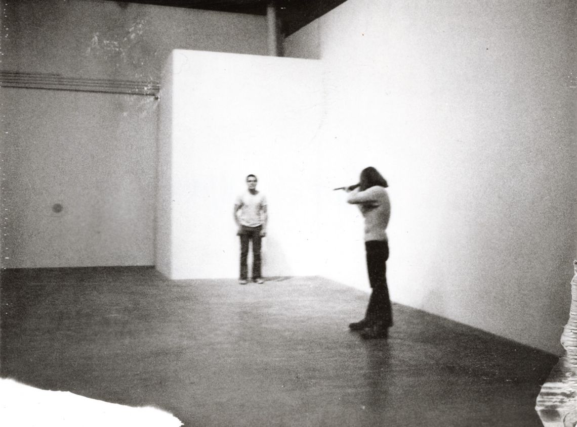 Chris Burden, Shoot (1971). F Space, Santa Ana, CA.November 19, 1971.At 7:45 p.m. I was shot in the left arm by a friend. The bullet was a copper jacket .22 long rifle. My friend was standing about fifteen feet from me.© Chris Burden. Courtesy of the artist and Gagosian Galler
