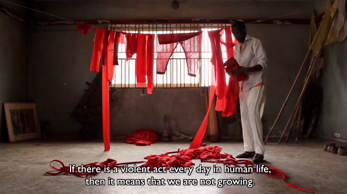 Jelili Atiku, Lagos in Red. Still from the short documentary film (2013). Courtesy of the artist.