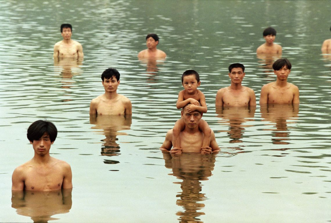 Zhang Huan, To Raise the Water Level in a Fishpond. Performance, Beijing, China (1997). Courtesy of Zhang Huan Studio.