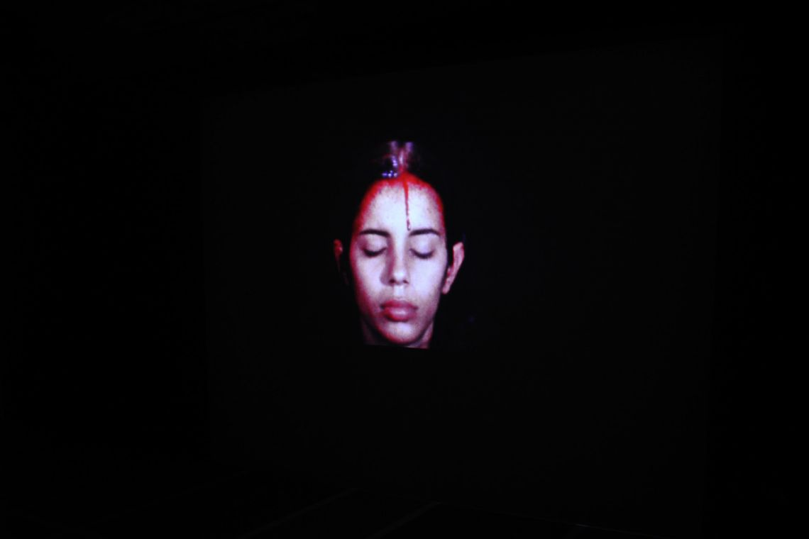 Ana Mendieta. Exhibition view of the super-8mm film transferred to high-definition digital media Sweating Blood (1973) at the III Venice International Performance Art Week 2016. Photograph by We Exhibit.