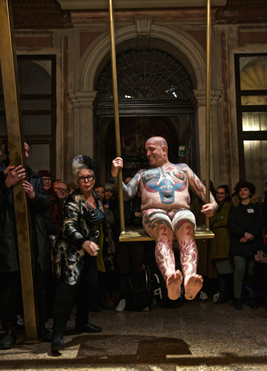 Franko B, I'm Thinking of You. Performance at the III Venice International Performance Art Week 2016. Franko B pushed on his golden swing by ORLAN. Image © Edward Smith