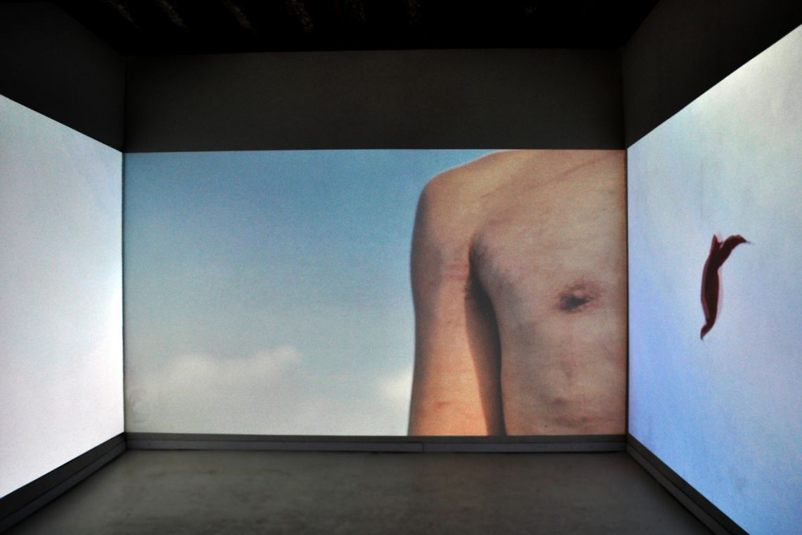 Tran Luong. Exhibition view of the three-channel video installation Lap Loe (2012) at the III Venice International Performance Art Week 2016. Image © We Exhibit